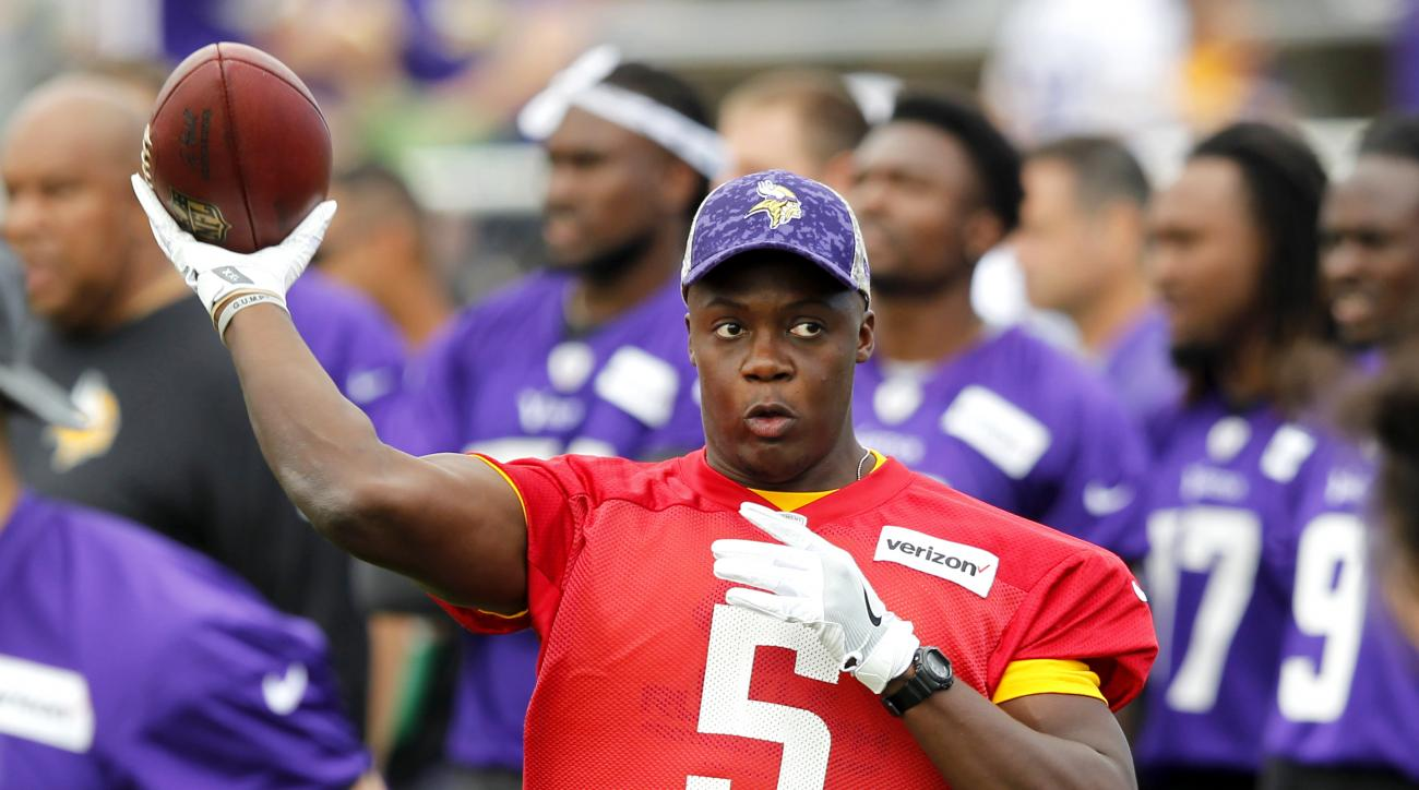 Minnesota Vikings quarterback Teddy Bridgewater (5) throws during the first day of NFL football training camp at Mankato State University in Mankato, Minn. on Friday, July, 29, 2016.(AP Photo/Andy Clayton-King)