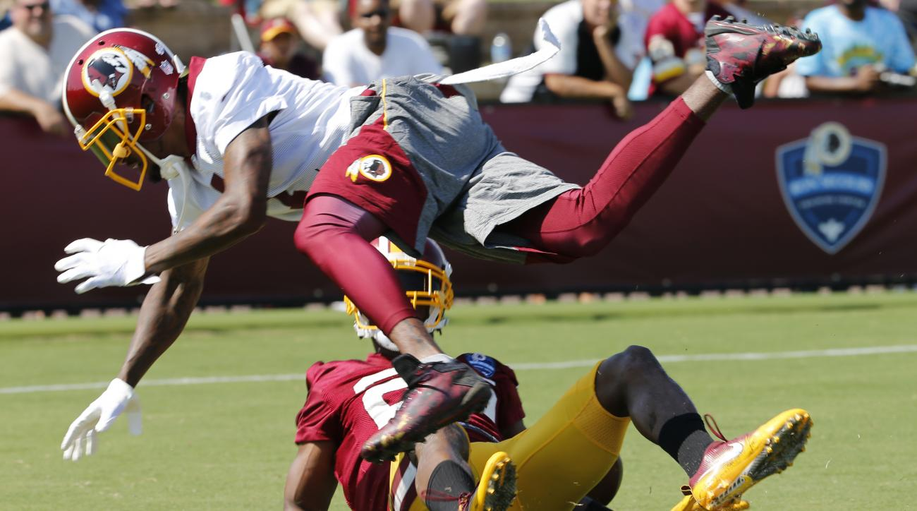 Washington Redskins wide receiver DeSean Jackson, top, leaps over Washington Redskins cornerback Bashaud Breeland (26) after Breeland broke up a pass play during the afternoon practice at the Washington Redskins NFL football teams training camp in Richmon