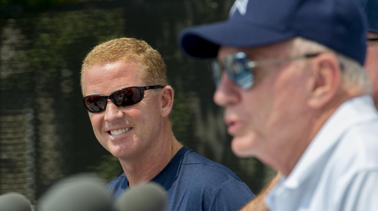 """Dallas Cowboys head coach Jason Garrett looks over at team owner Jerry Jones, right, as he addresses the media during the """"state of the team"""" press conference at the start of Dallas Cowboys' NFL football training camp, Friday, July 29, 2016, in Oxnard, Ca"""