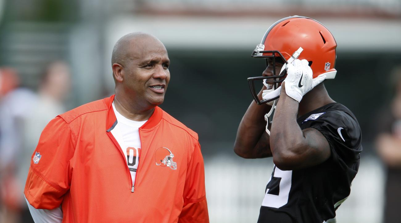 Cleveland Browns coach Hue Jackson, left, talks with wide receiver Corey Coleman during practice at the NFL football team's training camp Friday, July 29, 2016, in Berea, Ohio. (AP Photo/Ron Schwane)
