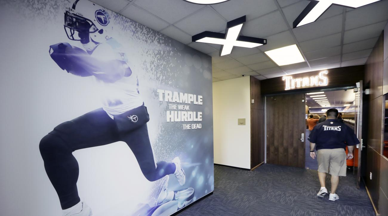 A tour is led into the renovated Tennessee Titans locker room before NFL football training camp Friday, July 29, 2016, in Nashville, Tenn. The team is scheduled to be on the practice field for the first day of camp Saturday. (AP Photo/Mark Humphrey)