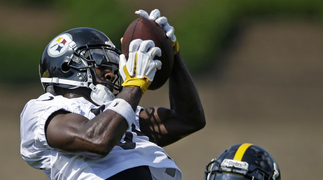 Pittsburgh Steelers wide receiver Antonio Brown, left, comes down with a pass in front of cornerback Montell Garner during a practice at the NFL football team's training camp in Latrobe, Pa., Friday, July 29, 2016.(AP Photo/Gene J. Puskar)