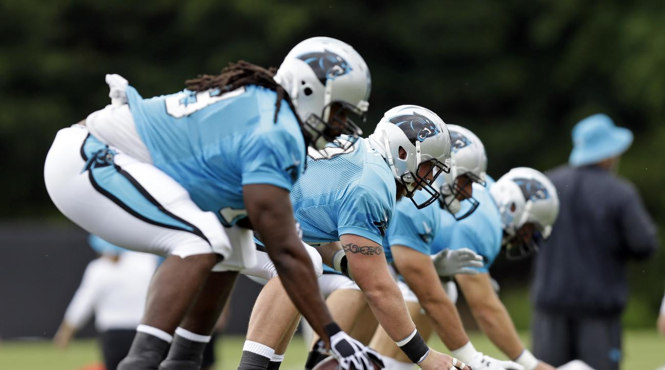 Carolina Panthers from left, Chris Scott, Reese Dismukes, Gino Gradkowski and Ryan Kalil line up during a drill at the NFL football team's training camp in Spartanburg, S.C., Saturday, July 30, 2016. (AP Photo/Gerry Broome)