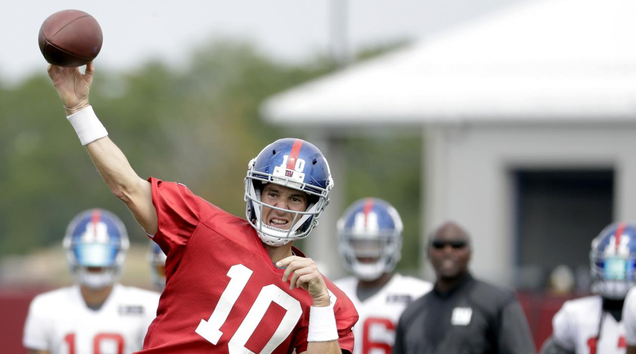 New York Giants quarterback Eli Manning throws a pass during NFL football training camp, Saturday, July 30, 2016, in East Rutherford, N.J. (AP Photo/Julio Cortez)