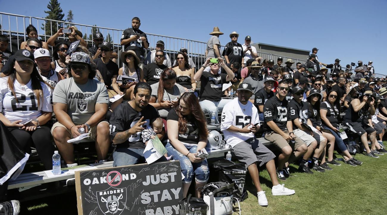 Oakland Raiders fans watch practice at the NFL football team's training camp Saturday, July 30, 2016, in Napa, Calif. (AP Photo/Eric Risberg)