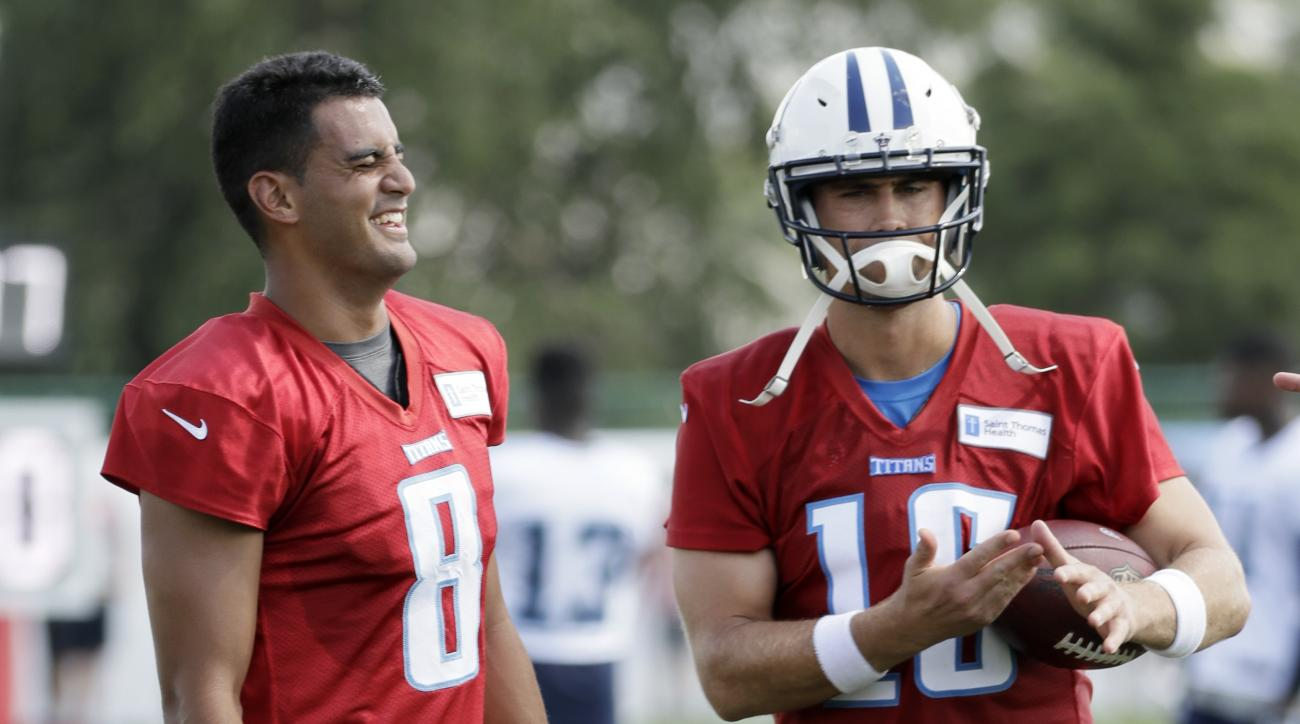 Tennessee Titans quarterbacks Marcus Mariota (8) and Matt Cassel (16) laugh during NFL football training camp Saturday, July 30, 2016, in Nashville, Tenn. (AP Photo/Mark Humphrey)