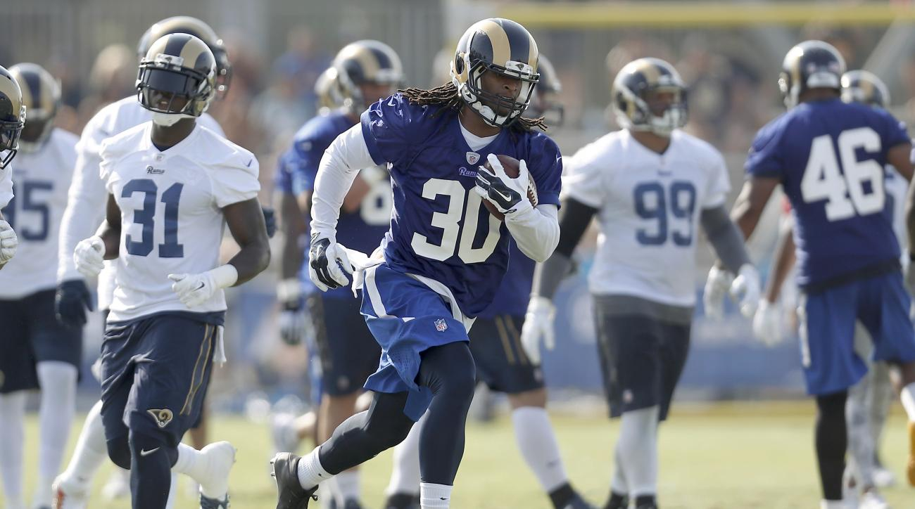 Los Angeles Rams running back Todd Gurley carries the football during the NFL football team's training camp Saturday, July 30, 2016, in Irvine, Calif. (AP Photo/Ryan Kang)