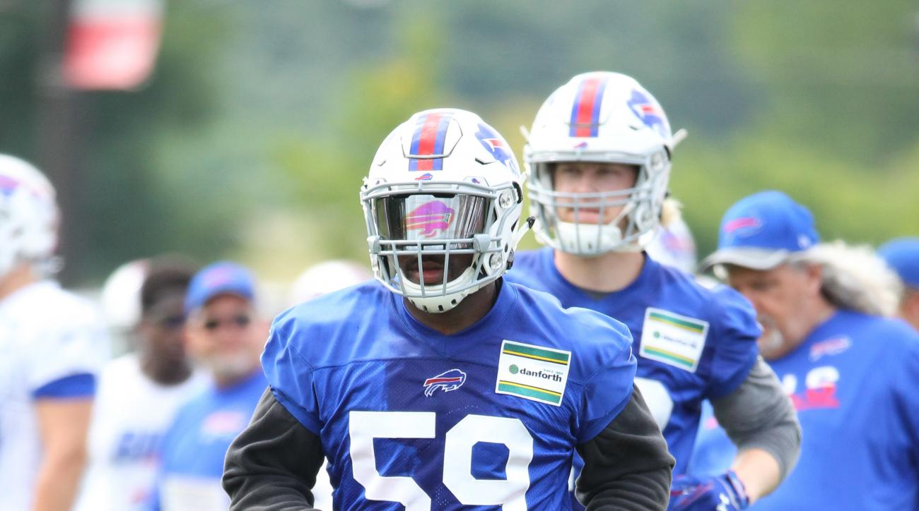Buffalo Bills linebacker Reggie Ragland (59) takes part in drills during NFL football training camp in Pittsford, N.Y., Sunday, July 31, 2016. (AP Photo/Bill Wippert)
