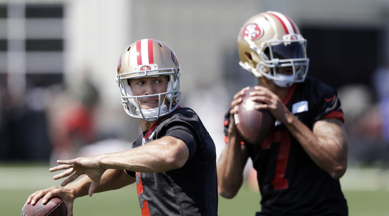San Francisco 49ers quarterbacks Blaine Gabbert, left, and Colin Kaepernick throw during NFL football training camp Sunday, July 31, 2016, in Santa Clara, Calif. (AP Photo/Marcio Jose Sanchez)