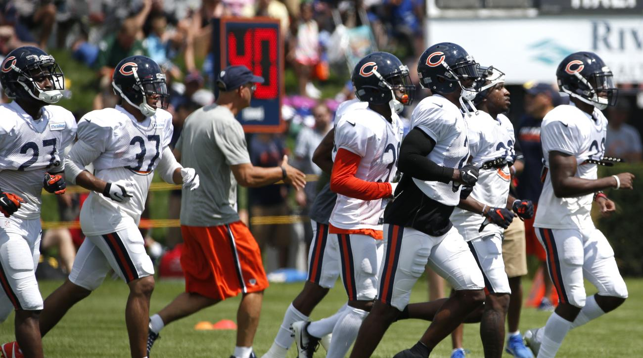 Chicago Bears defenders run on the field during practice at the NFL football team's training camp at Olivet Nazarene University, in Bourbonnais, Ill., Sunday, July 31, 2016. (AP Photo/Nam Y. Huh)