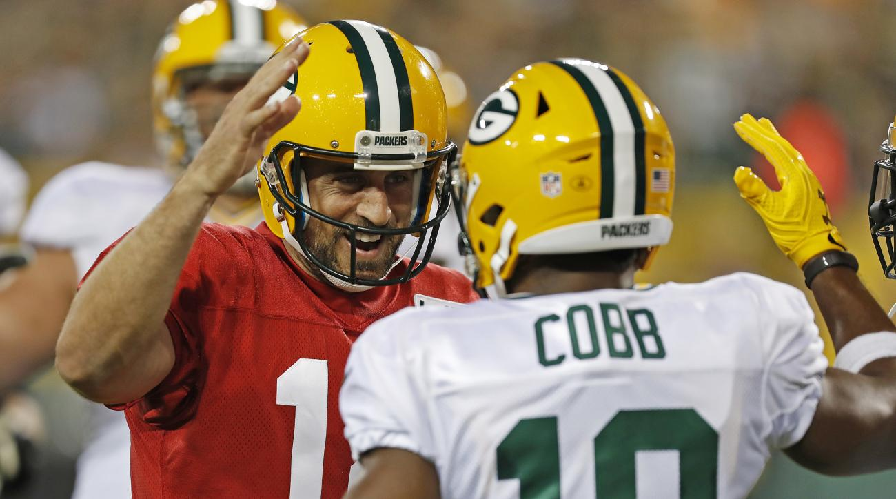 Green Bay Packers quarterback Aaron Rodgers (12) and wide receiver Randall Cobb (18) celebrate scoring a touchdown during NFL football training camp, Sunday, July 31, 2016, in Green Bay, Wis. (AP Photo/Matt Ludtke)