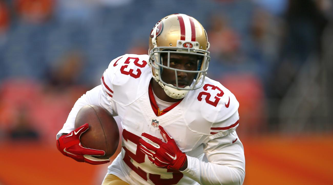 FILE - In this Aug. 29, 2015, file photo, San Francisco 49ers running back Reggie Bush (23) warms up prior to an NFL preseason football game against the Denver Broncos, in Denver. The Buffalo Bills brought in free-agent running back Reggie Bush for a visi