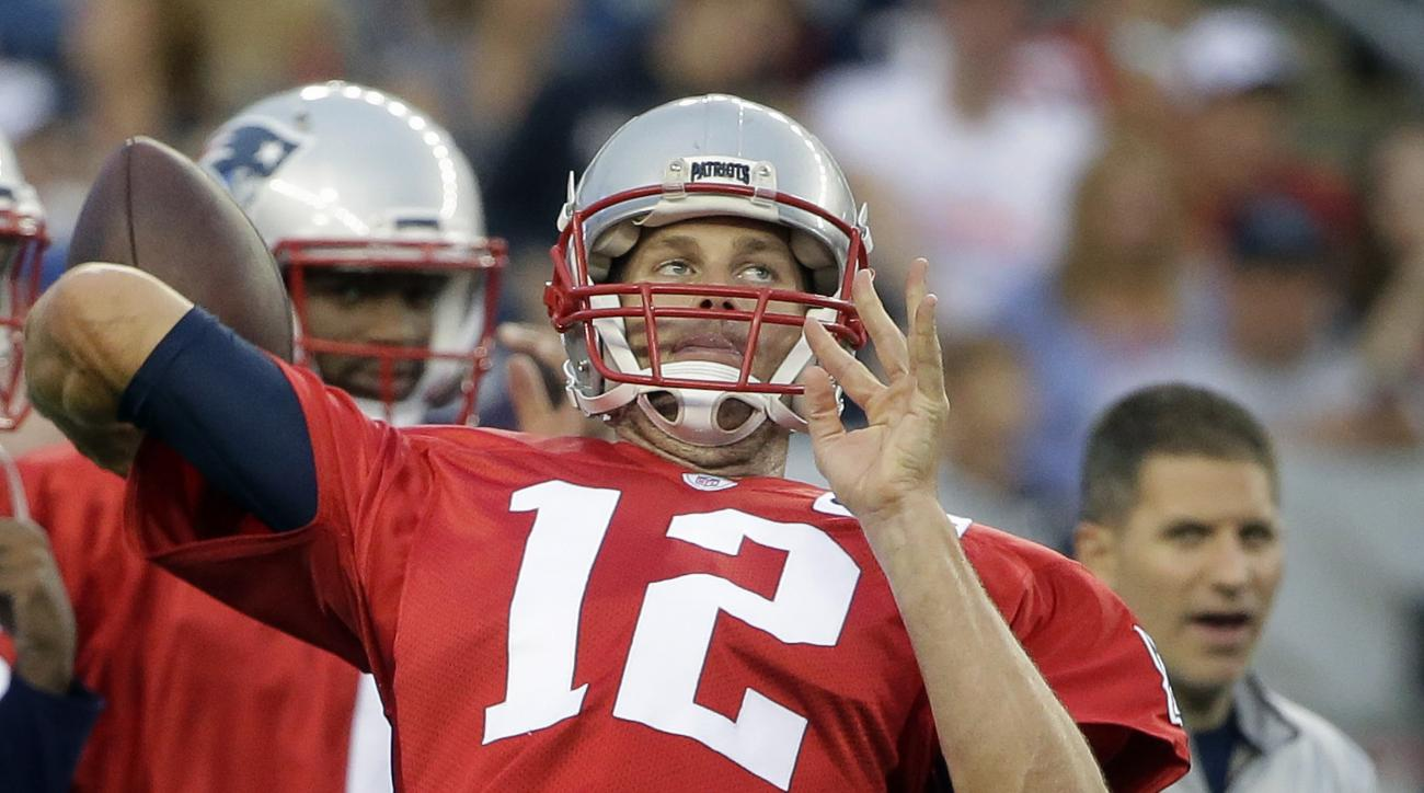 New England Patriots quarterback Tom Brady (12) winds up for a pass during an NFL football training camp practice, Monday, Aug. 1, 2016, in Foxborough, Mass. (AP Photo/Steven Senne)