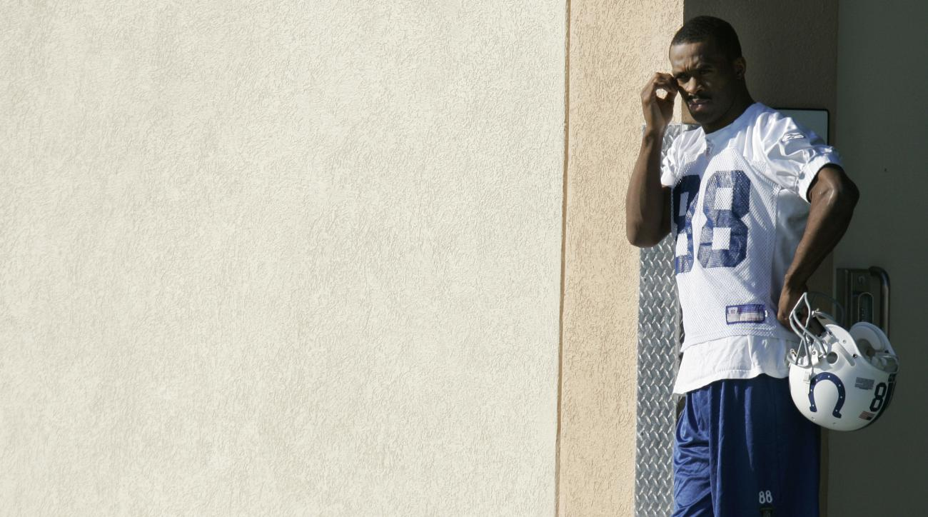FILE - In this Jan. 31, 2007, file photo, Indianapolis Colts wide receiver Marvin Harrison leans on the wall before the start of practice in Davie, Fla. Harrisons low-key, old-school approach fit perfectly with Peyton Manning in Indy and led the wiry rece