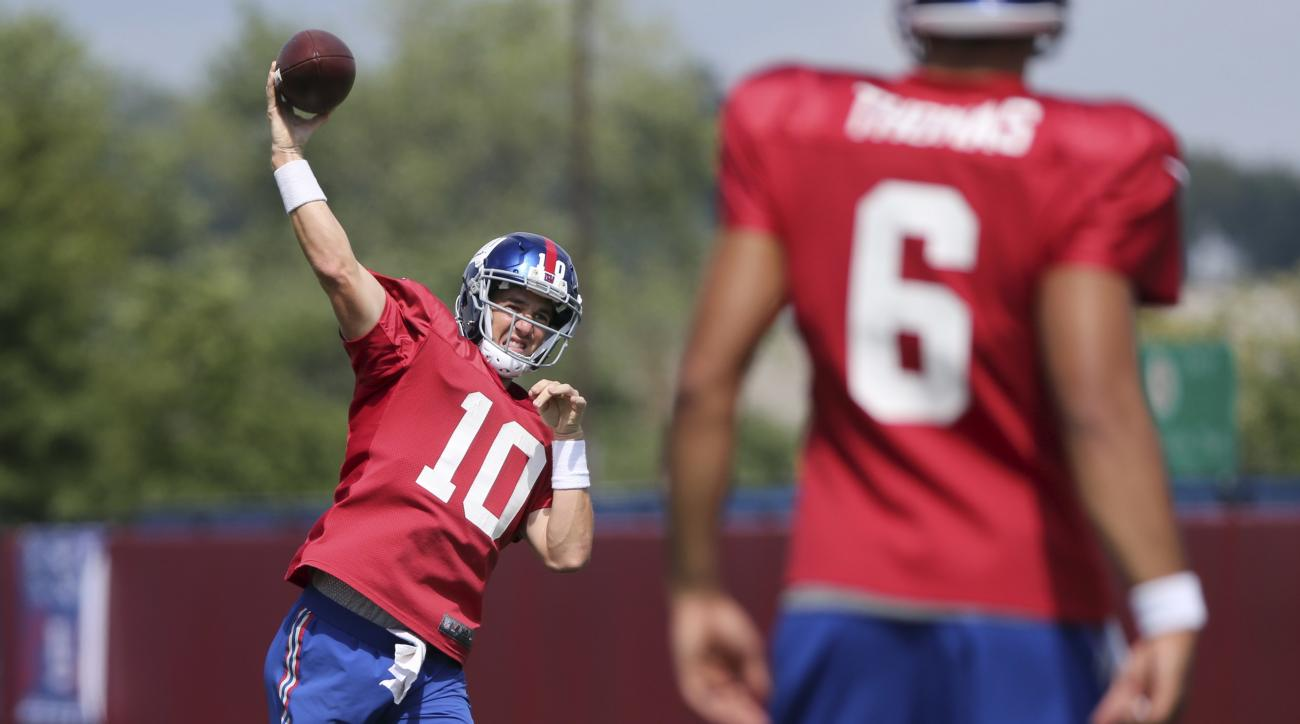 New York Giants quarterback Eli Manning throws during practice at the NFL football team's training camp in East Rutherford, N.J., Tuesday, Aug. 2, 2016. (AP Photo/Seth Wenig)