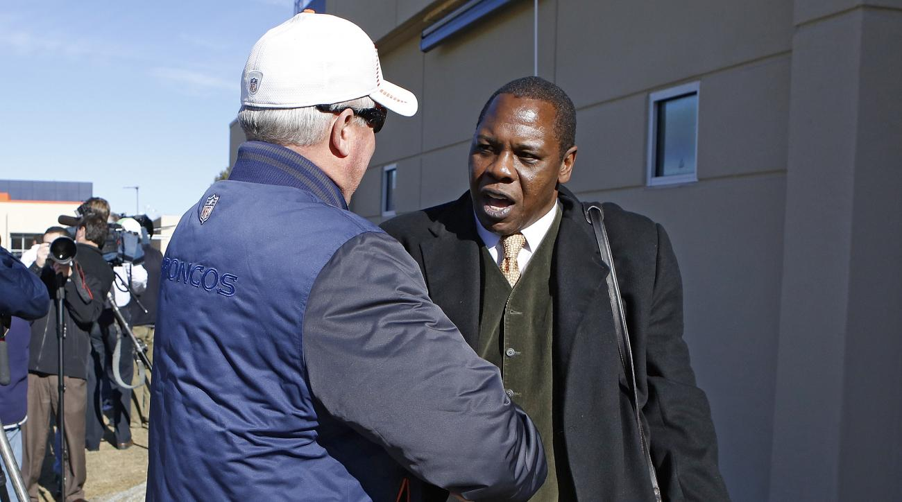 Denver Broncos head coach John Fox, left, greets former linebacker Tom Jackson during football practice at the team's training facility in Englewood, Colo., on Wednesday, Jan.9,  2013. The Broncos are scheduled to play the Baltimore Ravens in an NFL playo