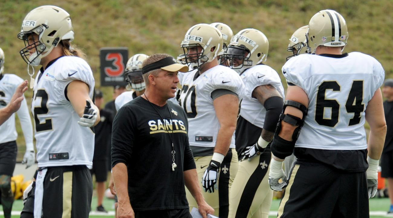 New Orleans Saints head coach Sean Payton instructs his players during NFL football training camp in White Sulphur Springs, W.Va., Wednesday, Aug. 3, 2016. (AP Photo/Chris Tilley)