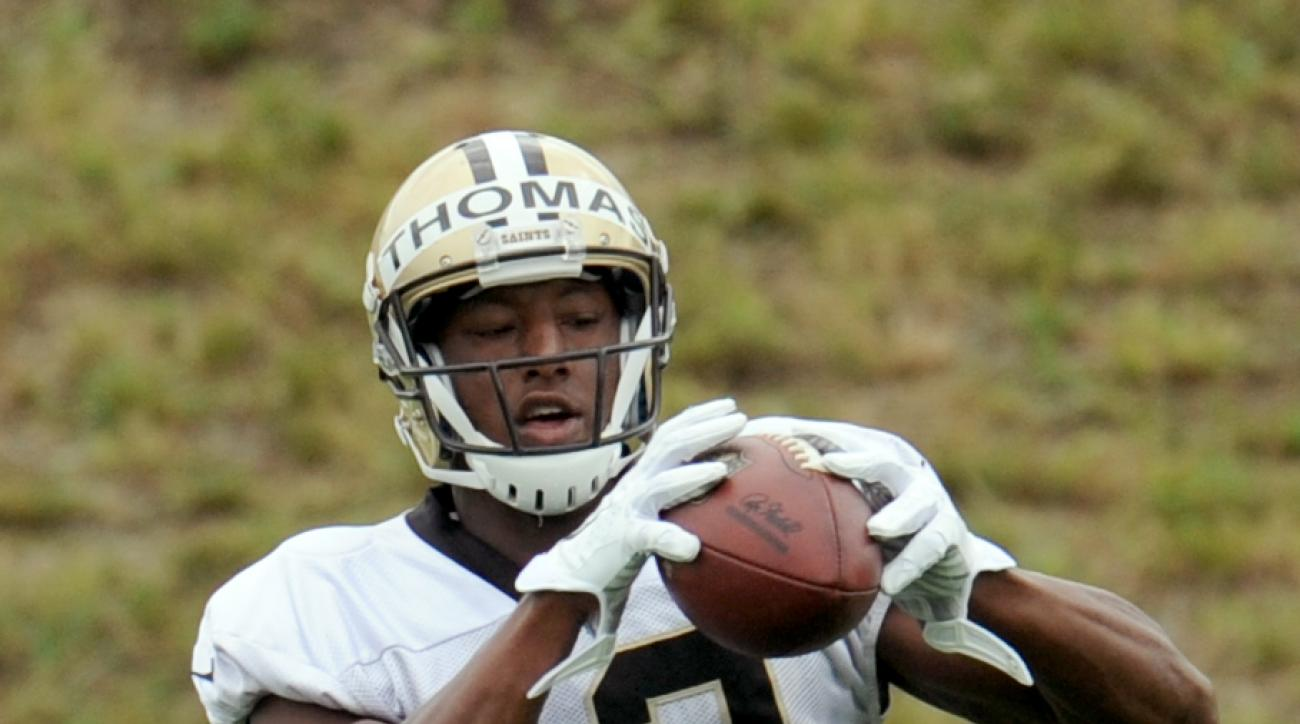 New Orleans Saints wide receiver Michael Thomas (13) pulls in a pass during NFL football training camp in White Sulphur Springs, W.Va., Wednesday, Aug. 3, 2016. (AP Photo/Chris Tilley)