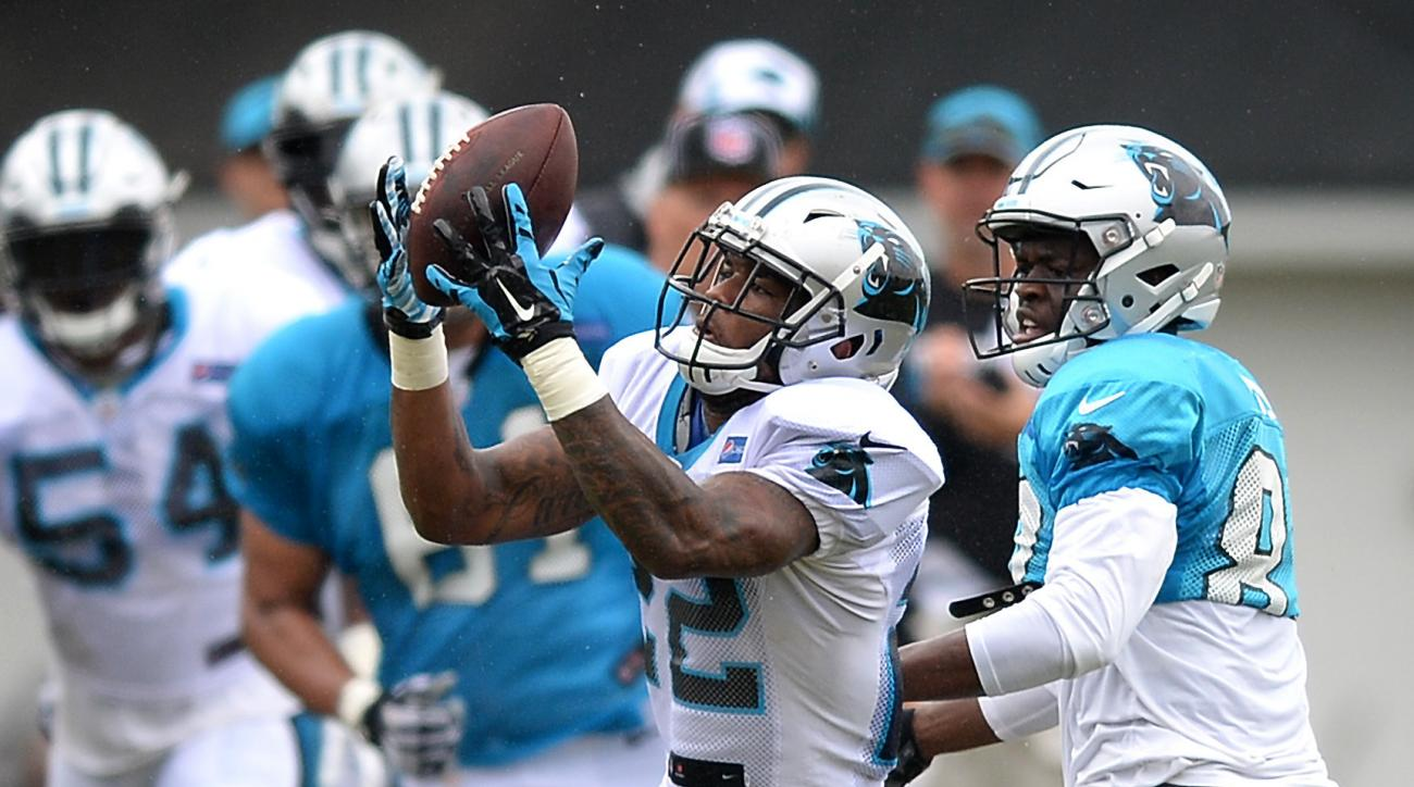Carolina Panthers cornerback Lou Young, center, intercepts a pass meant for wide receiver Stephen Hill, right, during practice at the NFL football team's training camp in Spartanburg, S.C., Wednesday, Aug. 3, 2016.  (Jeff Siner/The Charlotte Observer via