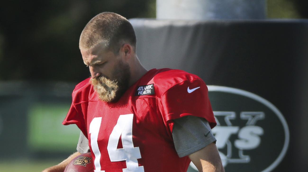 New York Jets quarterback Ryan Fitzpatrick leaves the field after practice at the NFL football team's training camp in Florham Park, N.J., Wednesday, Aug. 3, 2016. Fitzpatrick's freshly cut hair is all the buzz at training camp. The bushy-bearded quarterb