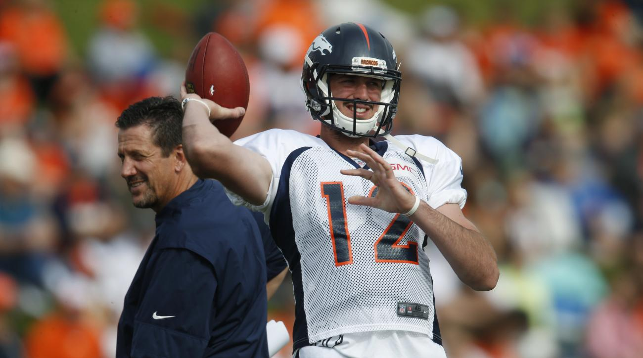 Denver Broncos quarterback Paxton Lynch takes part in drills as quarterbacks coach Greg Knapp looks on during the team's NFL football training camp Thursday, Aug. 4, 2016 in Englewood, Colo. (AP Photo/David Zalubowski)