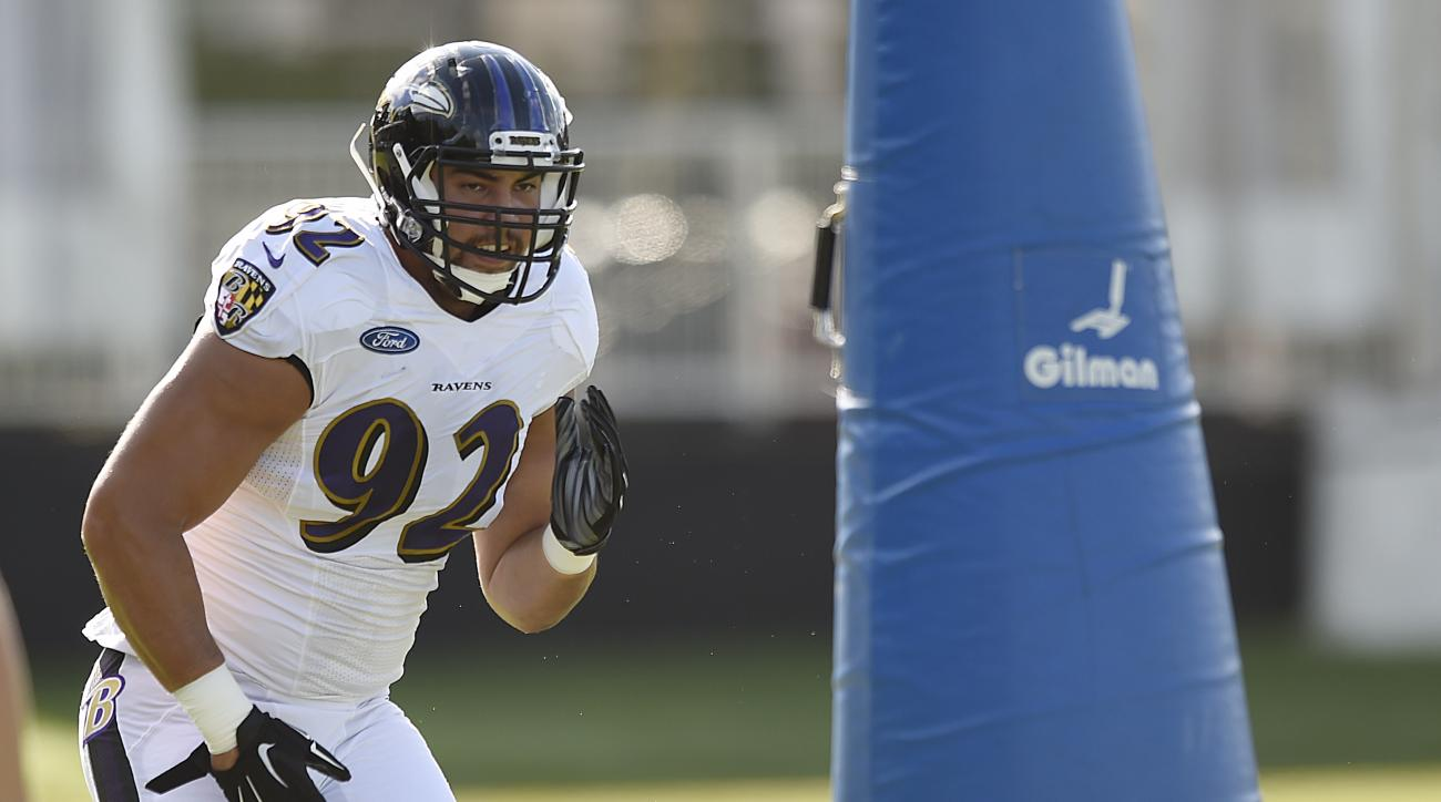 Baltimore Ravens defensive tackle Bronson Kaufusi runs a drill during NFL football training camp in Owings Mills, Md., Thursday,  Aug. 4, 2016. (AP Photo/Gail Burton)