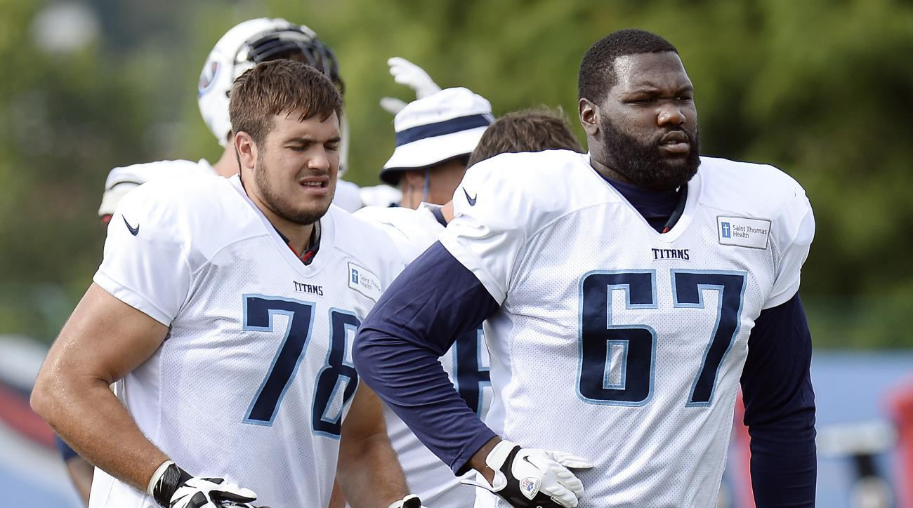 Tennessee Titans offensive tackle Jack Conklin (78) and offensive guard Quinton Spain (67) run off the field after a drill during NFL football training camp Thursday, Aug. 4, 2016, in Nashville, Tenn. (AP Photo/Mark Zaleski)