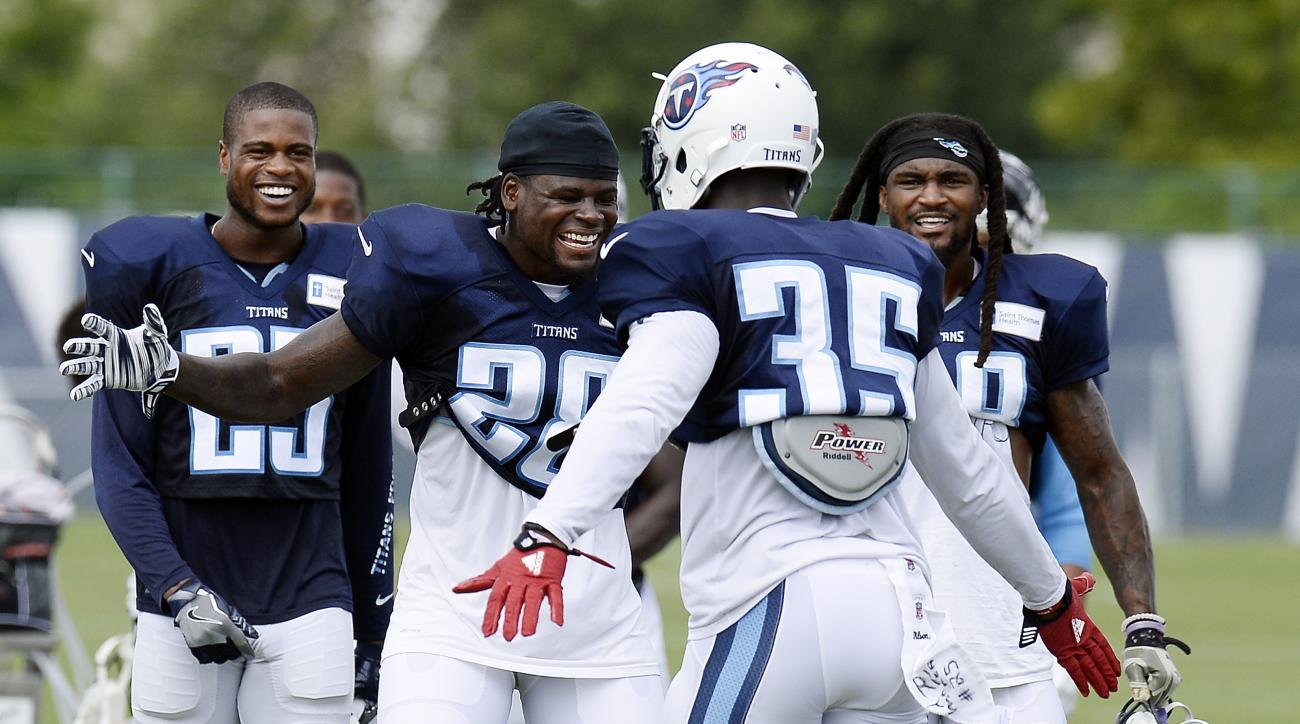 Tennessee Titans cornerback Curtis Riley (35) celebrates with strong safety Marqueston Huff, second from left, after Riley made a defensive stop in practice during NFL football training camp Thursday, Aug. 4, 2016, in Nashville, Tenn. (AP Photo/Mark Zales