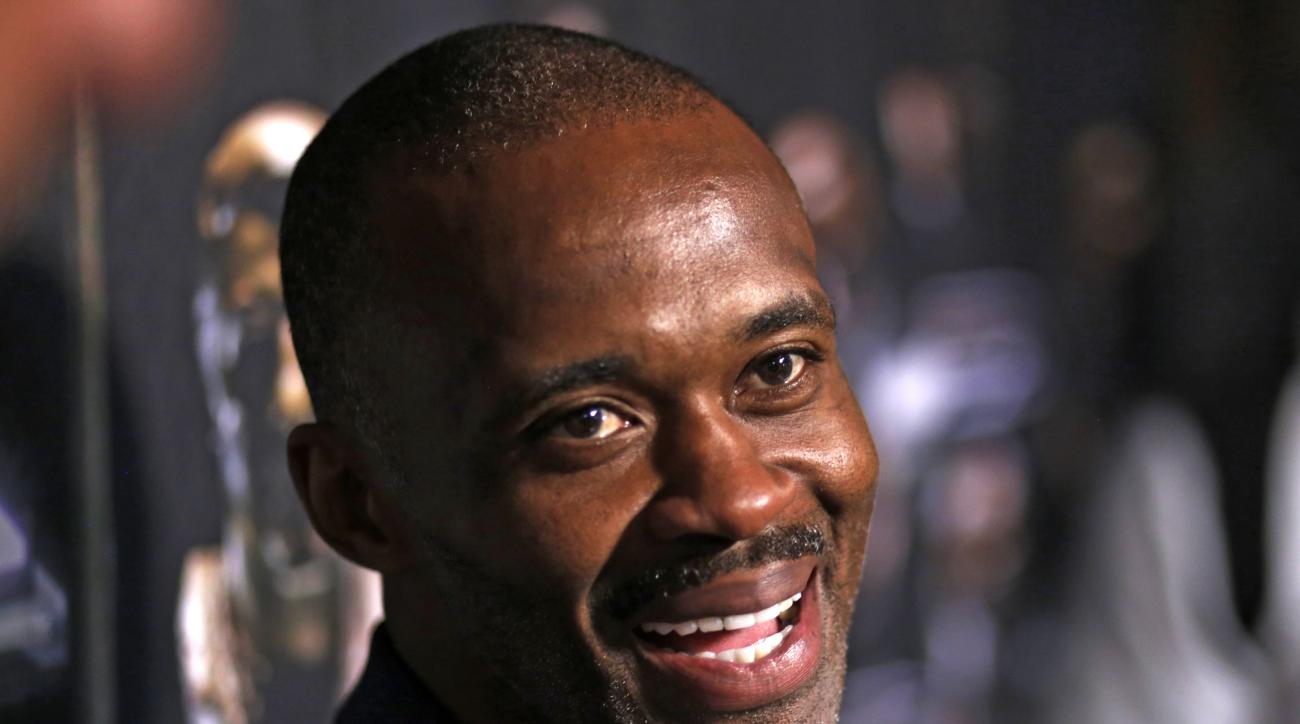 Pro Football Hall of Fame 2016 inductee Marvin Harrison talks with reporters Friday, Aug. 5, 2016, in Canton, Ohio. (AP Photo/Gene J. Puskar)