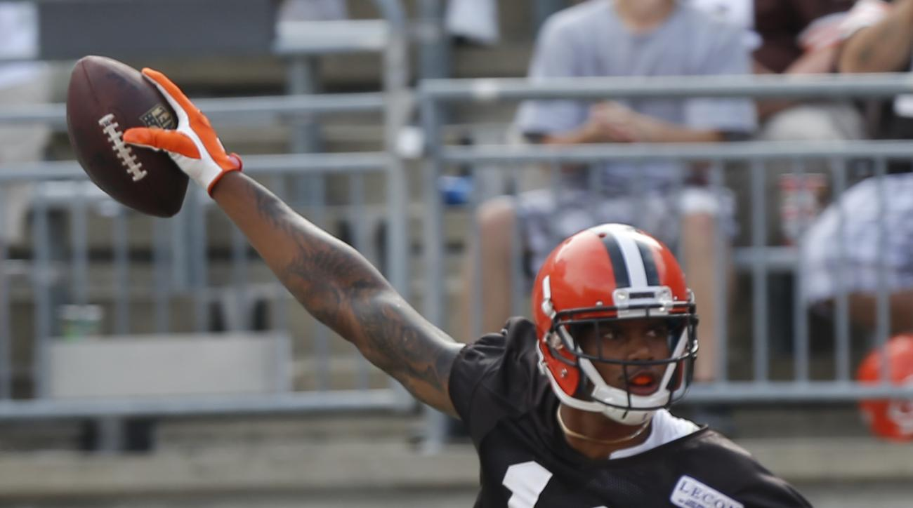 Cleveland Browns wide receiver Terrelle Pryor celebrates scoring a touchdown during their orange and brown scrimmage at the NFL football team's training camp Saturday, Aug. 6, 2016, in Columbus, Ohio. (AP Photo/Jay LaPrete)