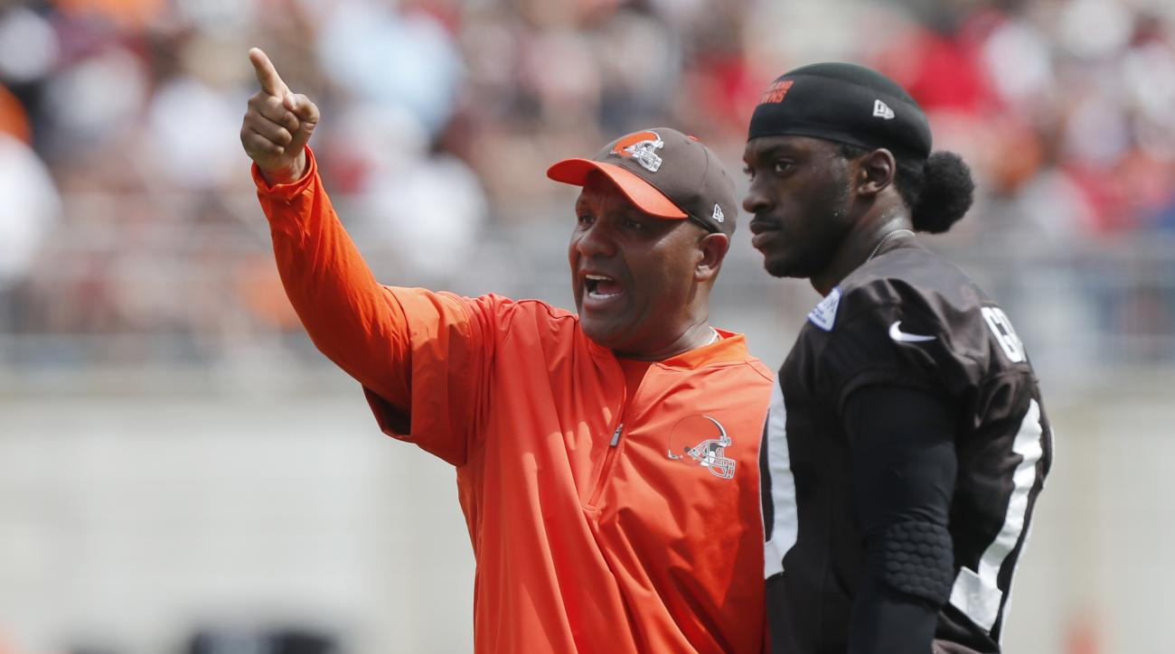 Cleveland Browns head coach Hue Jackson, left, talks with quarterback Robert Griffin III during their orange and brown scrimmage at the NFL football team's training camp Saturday, Aug. 6, 2016, in Columbus, Ohio. (AP Photo/Jay LaPrete)