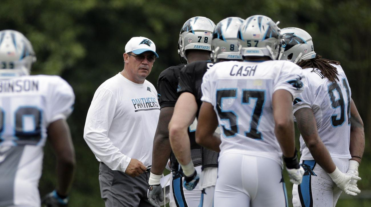 Carolina Panthers head coach Ron Rivera, center, stops players during a drill during an NFL training camp practice in Spartanburg, S.C., Monday, Aug. 8, 2016. (AP Photo/Chuck Burton)
