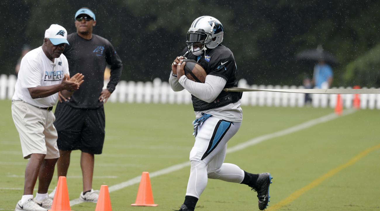 Carolina Panthers' Mike Tolbert runs a drill during an NFL training camp practice in Spartanburg, S.C., Monday, Aug. 8, 2016. (AP Photo/Chuck Burton)
