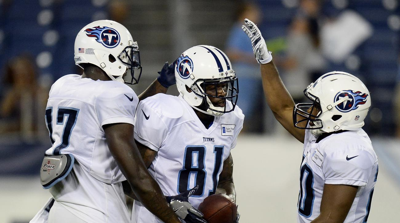 Tennessee Titans wide receiver Andre Johnson (81) celebrates with wide receivers Dorial Green-Beckham, left, and Tre McBride, right, after catching a touchdown pass during NFL football training camp scrimmage, Monday, Aug. 8, 2016, in Nashville, Tenn. (AP