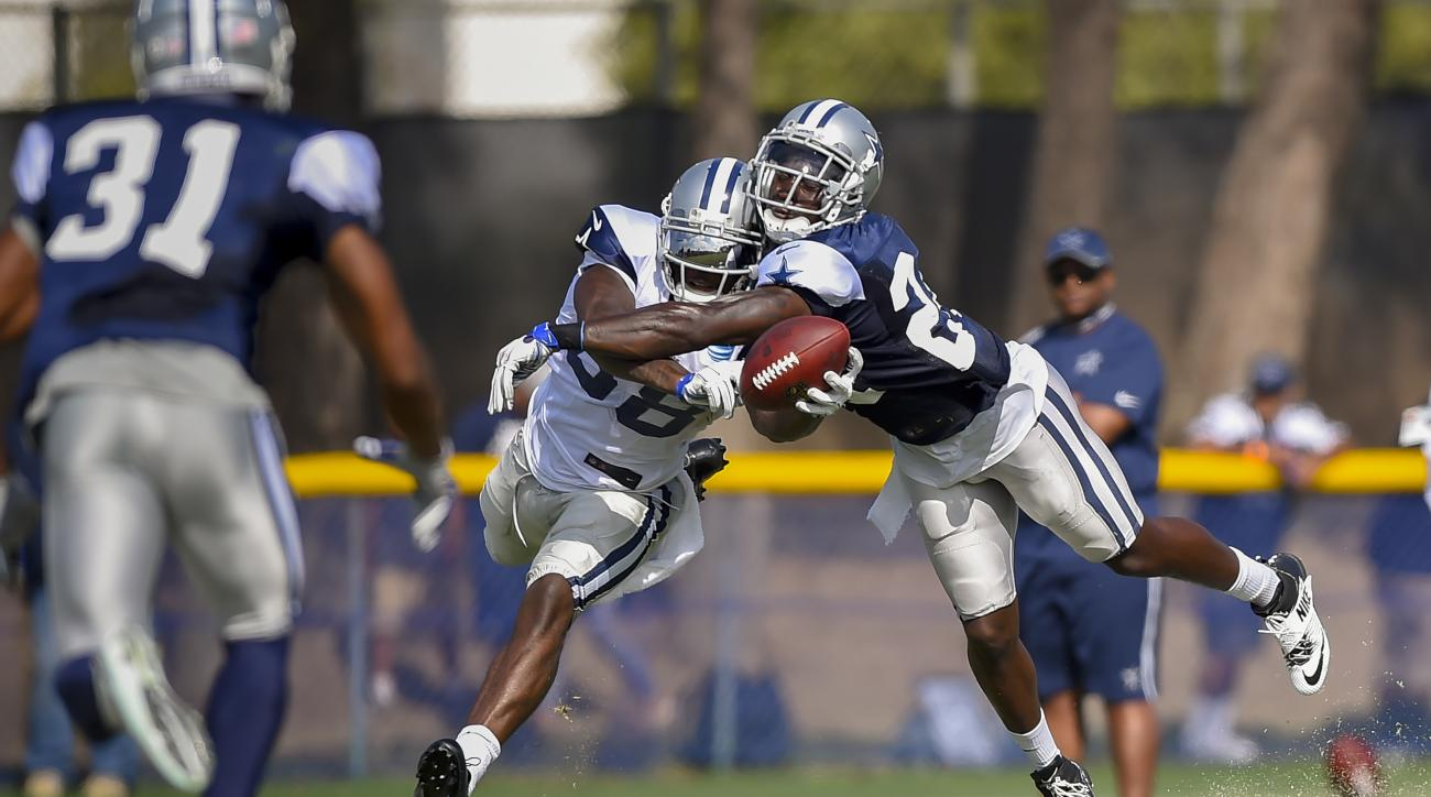 FILE - In this Aug. 2, 2016, file photo, Dallas Cowboys wide receiver Dez Bryant (88) collides with cornerback Morris Claiborne, right, as they go for a pass during practice during NFL football training camp in Oxnard, Calif. Owner Jerry Jones believes th