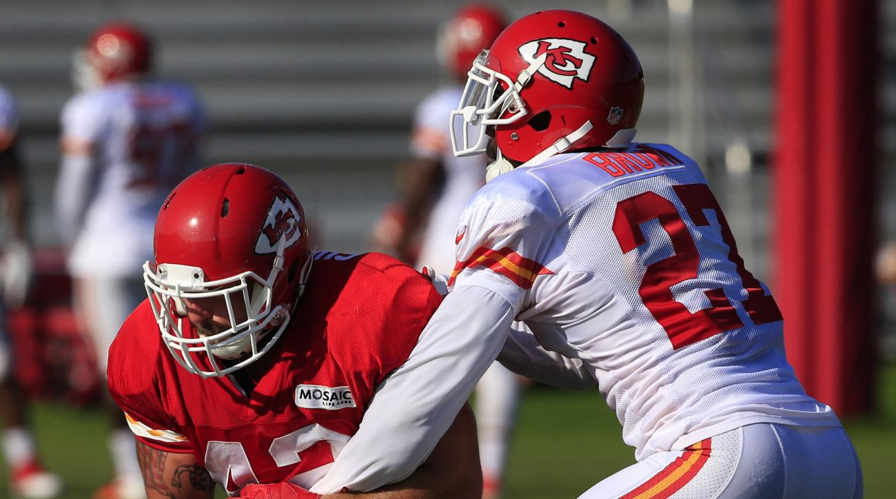 Kansas City Chiefs fullback Anthony Sherman (42) makes a catch while covered by defensive back Stevie Brown (27) during NFL football training camp in St. Joseph, Mo., Wednesday, Aug. 10, 2016. (AP Photo/Orlin Wagner)