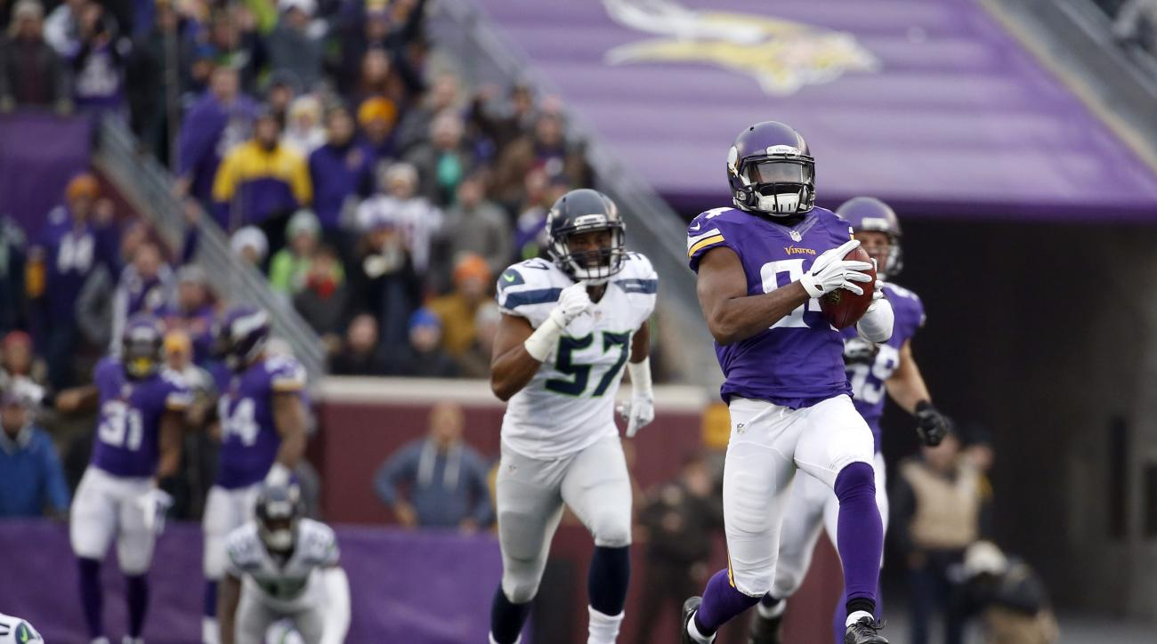 FILE - In this Dec. 6, 2015, file photo, Minnesota Vikings wide receiver Cordarrelle Patterson (84) runs on a 101-yard kickoff return for a touchdown against the Seattle Seahawks in the second half of an NFL football game in Minneapolis. Philadelphia spec