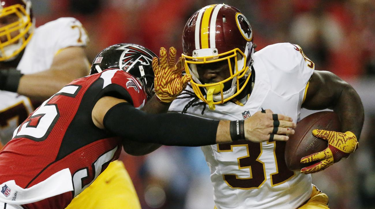 Washington Redskins running back Matt Jones (31) runs against Atlanta Falcons middle linebacker Paul Worrilow (55) during the first half of a preseason NFL football game, Thursday, Aug. 11, 2016, in Atlanta. (AP Photo/Brynn Anderson)