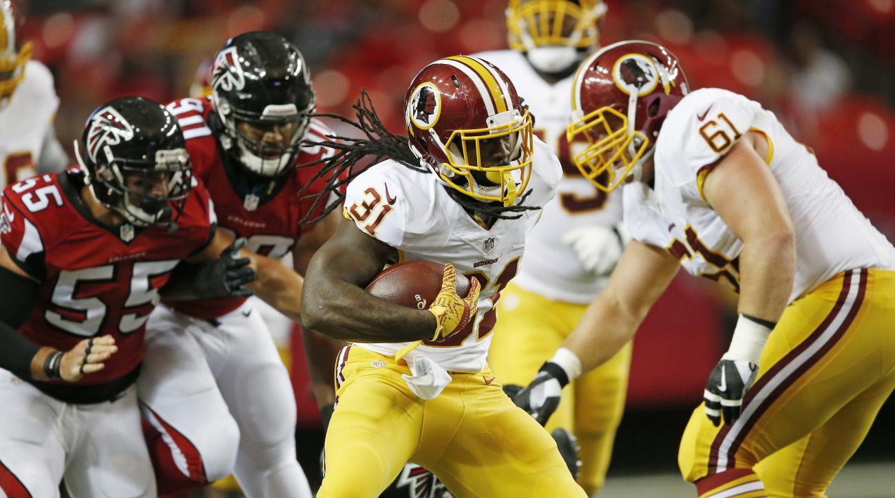 Washington Redskins running back Matt Jones (31) runs against the Atlanta Falcons during the first half of a preseason NFL football game, Thursday, Aug. 11, 2016, in Atlanta. (AP Photo/John Bazemore)