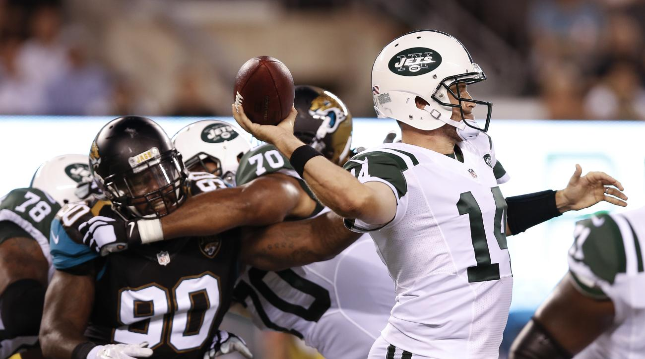 New York Jets quarterback Ryan Fitzpatrick (14) throws against the Jacksonville Jaguars during the first quarter of an NFL football game, Thursday, Aug. 11, 2016, in East Rutherford, N.J. (AP Photo/Kathy Willens)