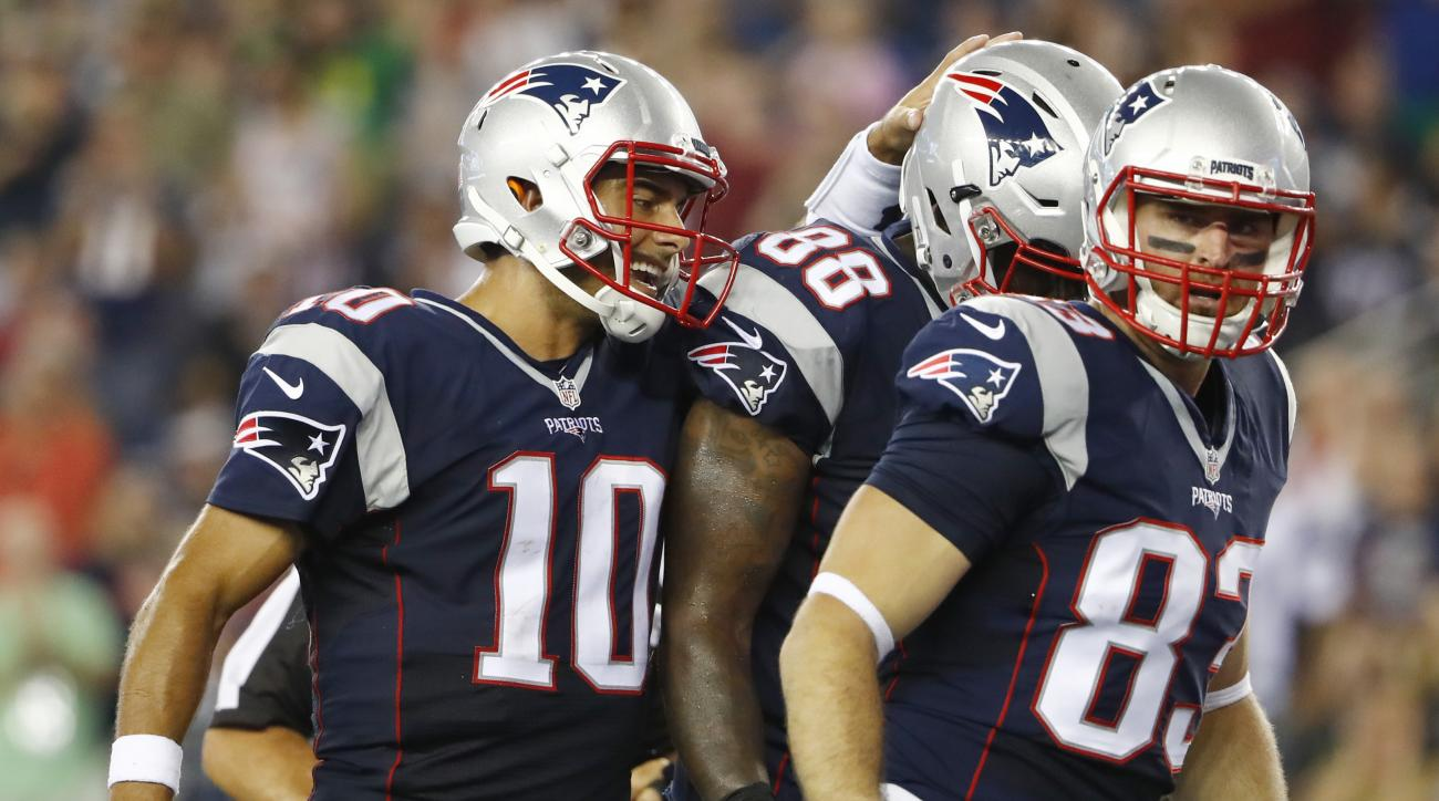 New England Patriots quarterback Jimmy Garoppolo (10) encourages tight ends Martellus Bennett (88) and Bear Pascoe (83) during the first half of a preseason NFL football game against the New Orleans Saints Thursday, Aug. 11, 2016, in Foxborough, Mass. (AP