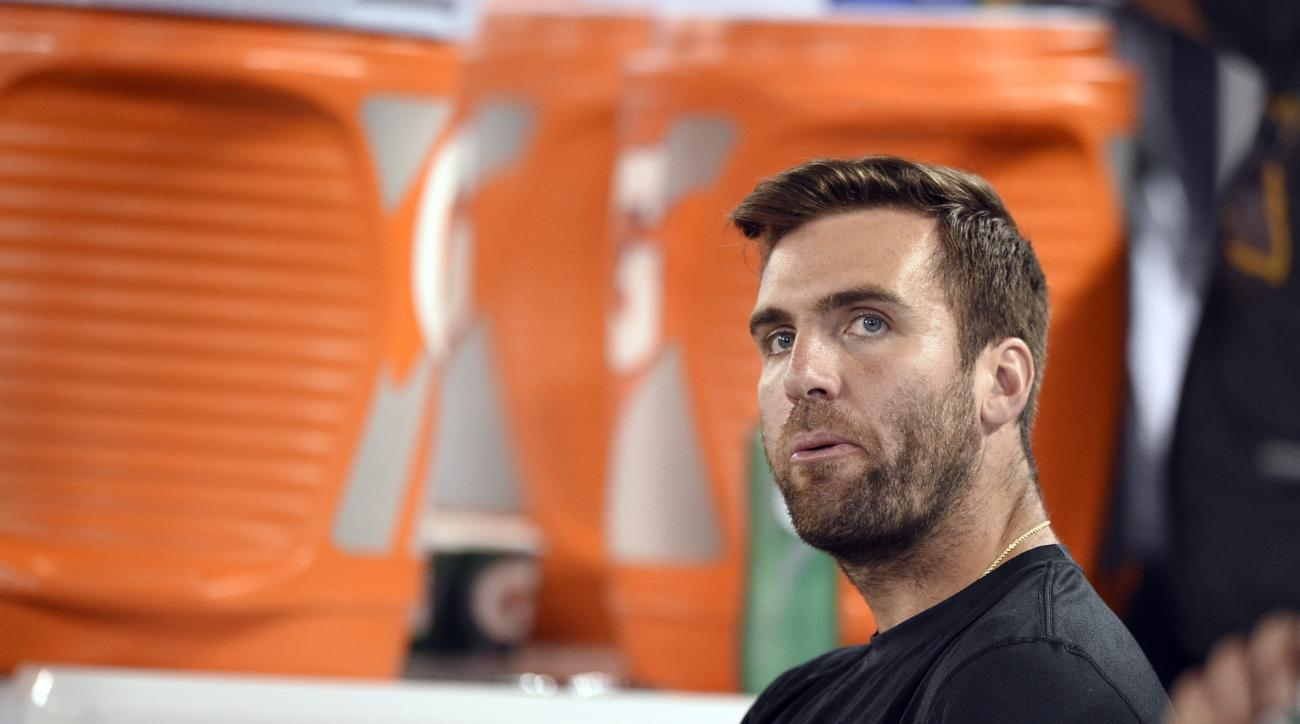 FILE - In this Thursday, Aug. 11, 2016, file photo, Baltimore Ravens quarterback Joe Flacco sits on the bench during the first half of an NFL preseason football game against the Carolina Panthers in Baltimore. Flacco is seeking to return from a season-end