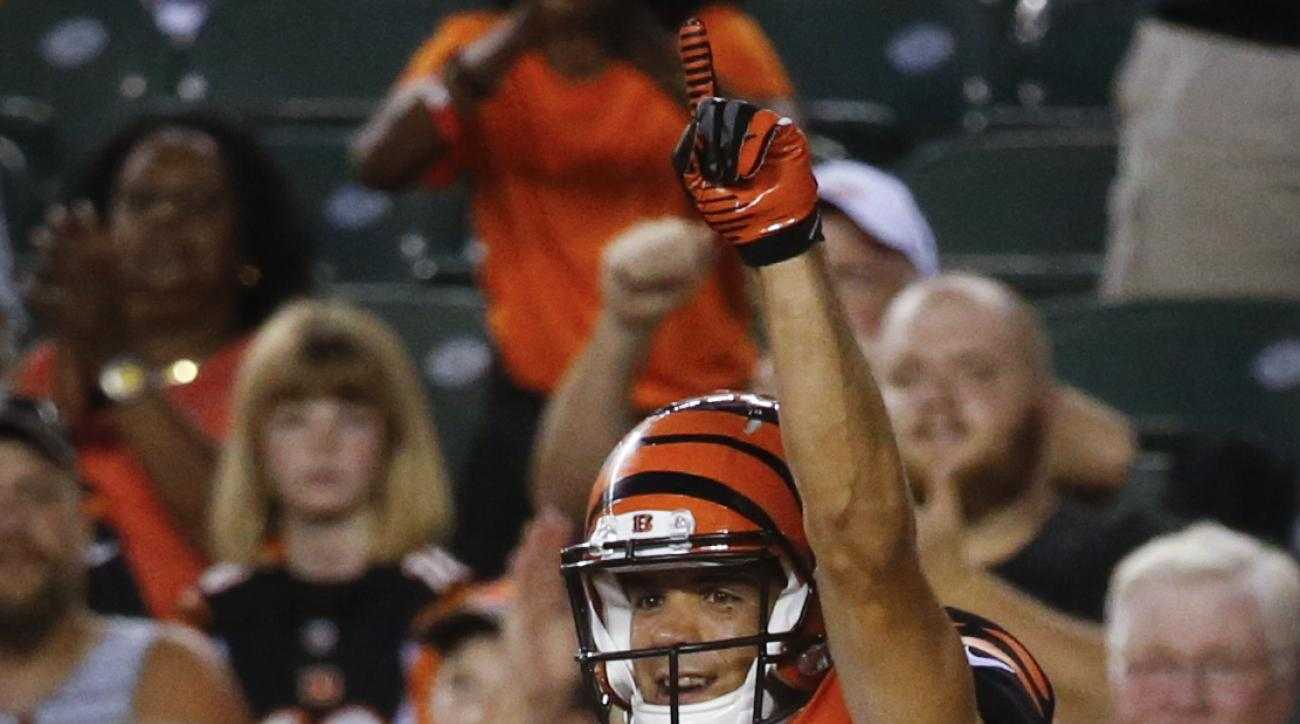 Cincinnati Bengals wide receiver Alex Erickson, above, celebrates with offensive guard Christian Westerman (63) after scoring a touchdown during the first half of an NFL preseason football game against the Minnesota Vikings, Friday, Aug. 12, 2016, in Cinc