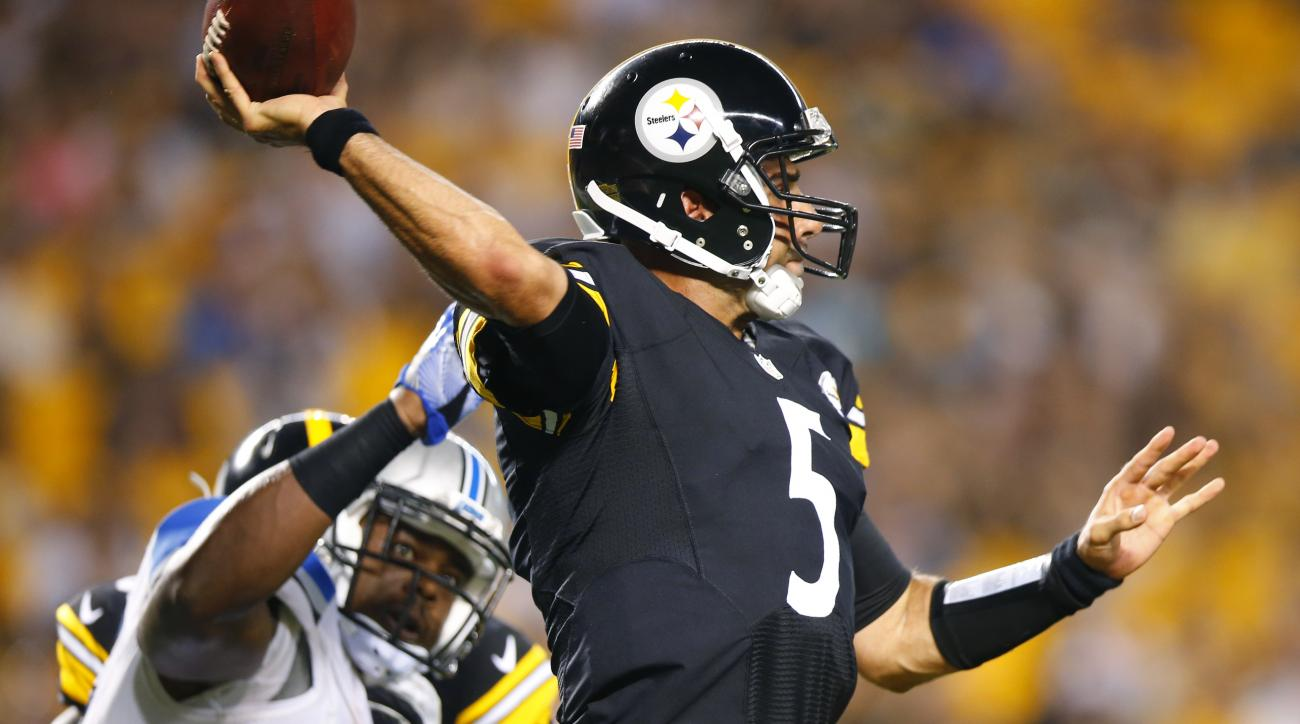Pittsburgh Steelers quarterback Bruce Gradkowski (5) passes under pressure from Detroit Lions outside linebacker Tahir Whitehead during second half of an NFL exhibition football game in Pittsburgh, Friday, Aug. 12, 2016. (AP Photo/Jared Wickerham)