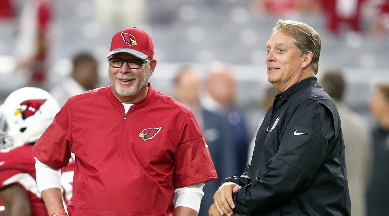 Arizona Cardinals coach Bruce Arians, left, talks with Oakland Raiders coach Jack Del Rio before an NFL preseason football game, Friday, Aug. 12, 2016, in Glendale, Ariz. (AP Photo/Rick Scuteri)
