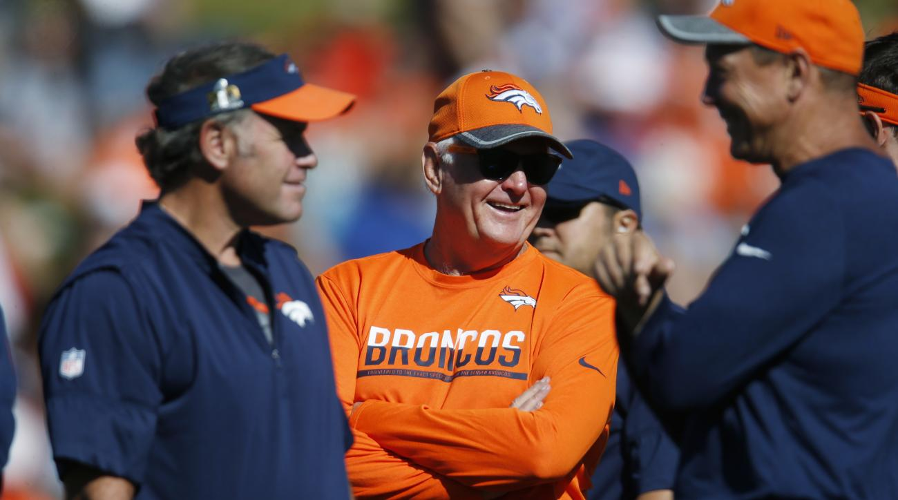 Denver Broncos defensive coordinator Wade Phillips, center, jokes with special teams coordinator Joe DeCamillis, left, and offensive coordinator Rick Dennison during drills at the team's NFL football training camp Saturday, Aug. 13, 2016 in Englewood, Col