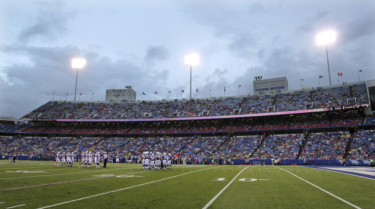 The Buffalo Bills and the Indianapolis Colts huddle during the first half of a preseason NFL football game at Ralph Wilson Stadium Saturday, Aug. 13, 2016, in Orchard Park, N.Y. The Bills announced on their Twitter account on Saturday they reached an agre