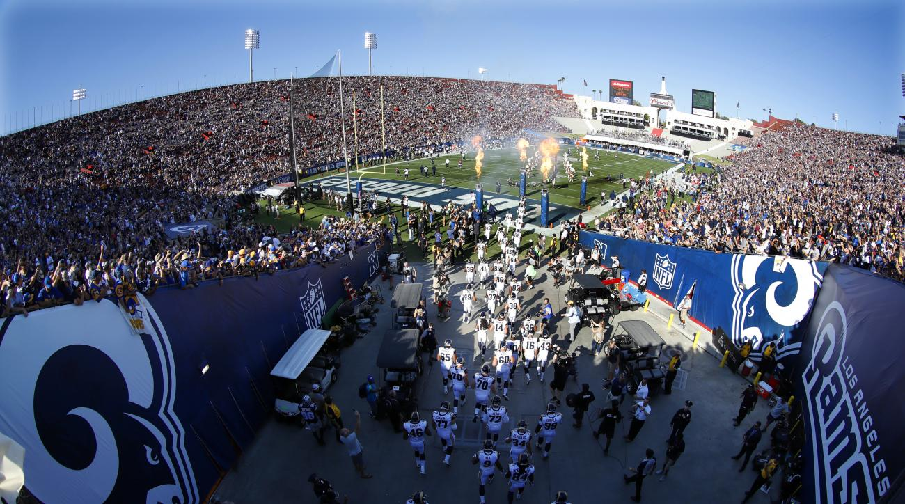 The Los Angeles Rams take the field at Los Angeles Memorial Coliseum for a preseason NFL football game against the Dallas Cowboys, Saturday, Aug. 13, 2016, in Los Angeles. (AP Photo/Ryan Kang)