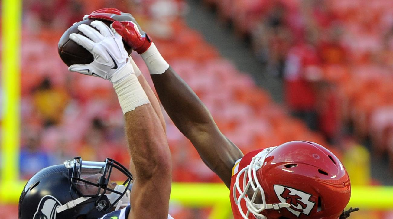 Seattle Seahawks wide receiver Tyler Slavin (8) makes a catch against Kansas City Chiefs defensive back Malcolm Jackson (48) during the second half of an NFL preseason football game in Kansas City, Mo., Saturday, Aug. 13, 2016. (AP Photo/Ed Zurga)