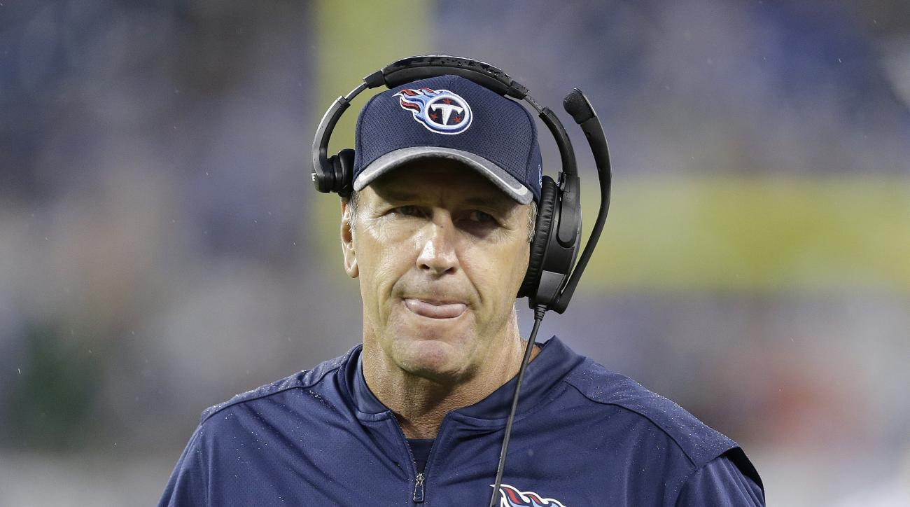 Tennessee Titans head coach Mike Mularkey walks on the sidelines during the first half of an NFL preseason football game against the San Diego Chargers, Saturday, Aug. 13, 2016, in Nashville, Tenn. (AP Photo/James Kenney)